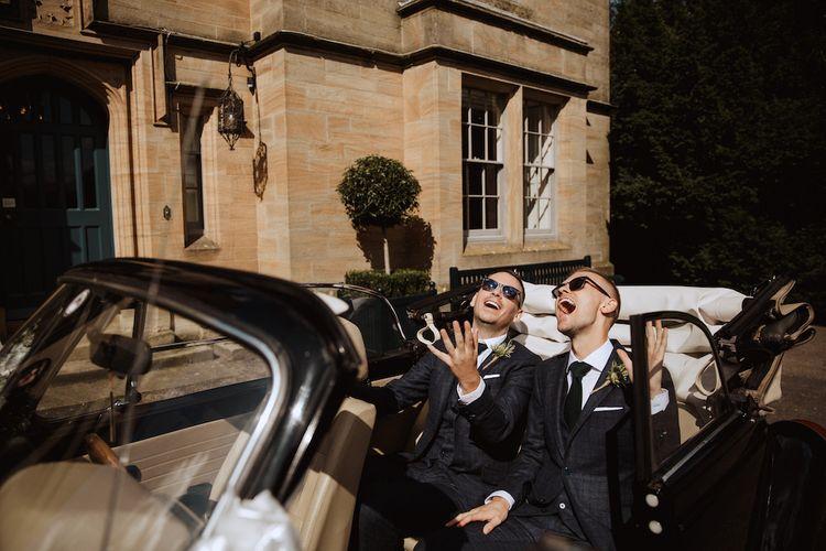 Two Groom Sitting in Their Wedding Car