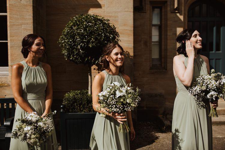 Bridesmaids in Green Dessy Halterneck Dresses