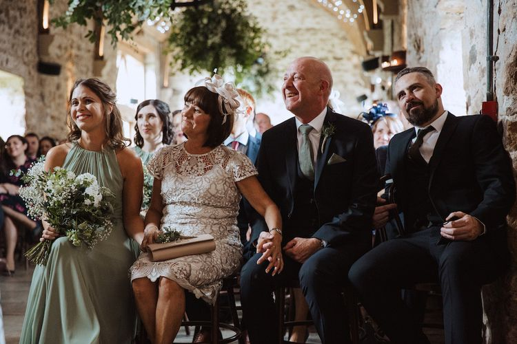 Grooms Family Watching the Gay Wedding Ceremony