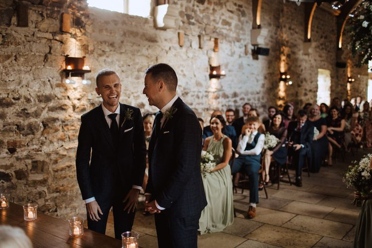 Two Grooms Laughing at the Altar of Their Healey Barn Wedding