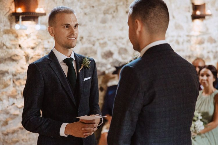 Two Grooms Exchanging Vows at Their Gay Wedding