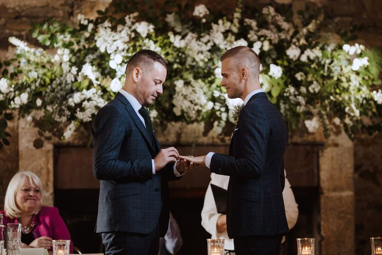 Two Grooms Exchanging Rings  at Their Same-sex Wedding