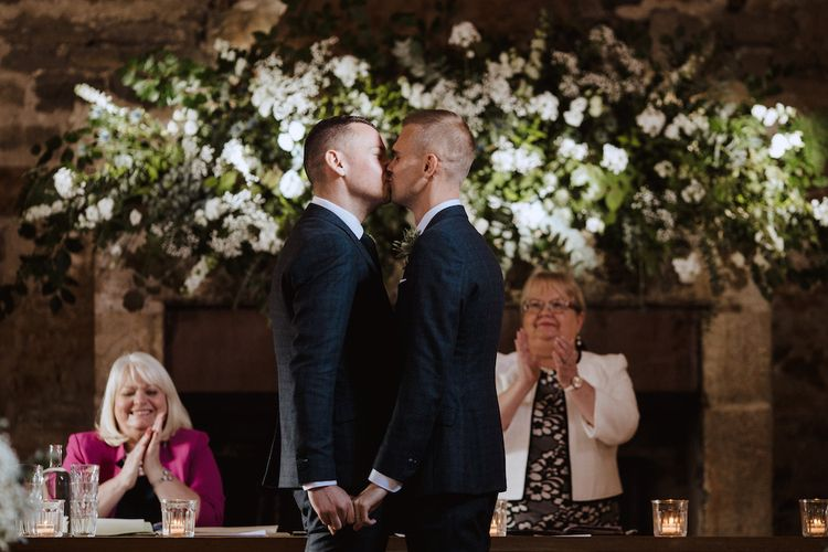 Two Grooms Kissing  at Their Same-sex Wedding
