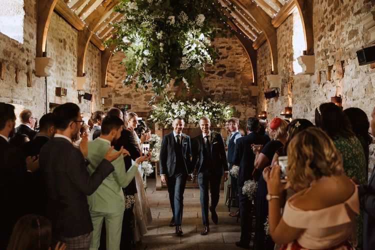 Two Grooms Walking Down the Aisle as Husband and Husband