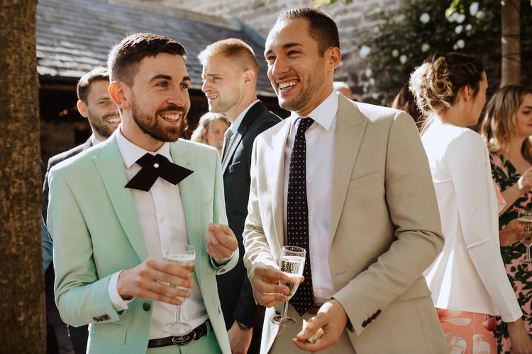 Wedding Guests in Stylish Green and Beige Suits