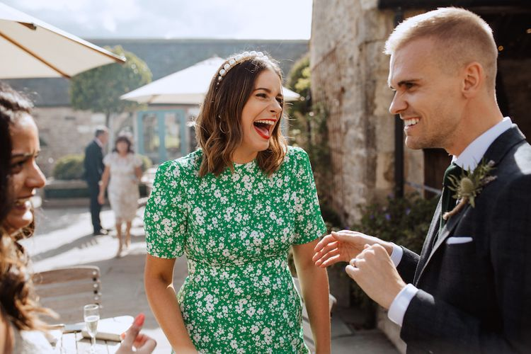 Wedding Guest in Green and White Dress with Pearl Alice Band