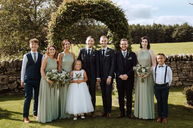 Wedding Party Portrait with Bridesmaids in Green Dresses and Grooms in Tailored Suits