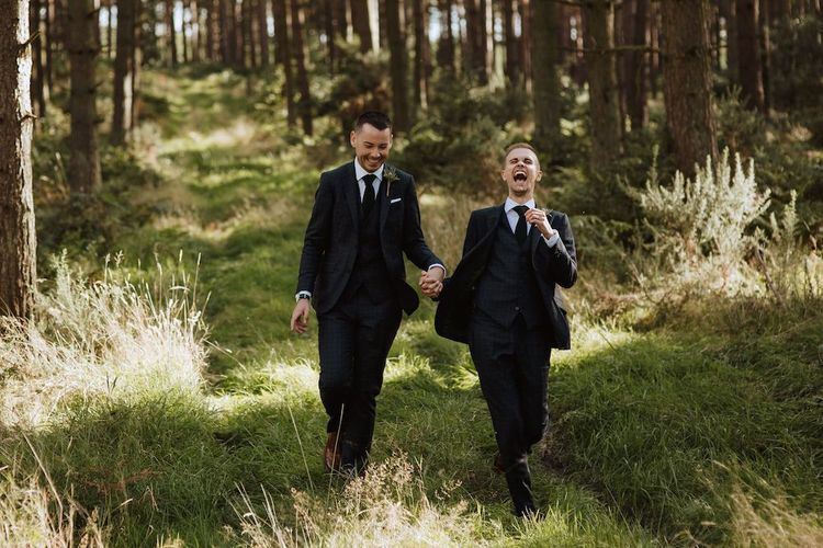 Two Grooms Laughing in the Woods
