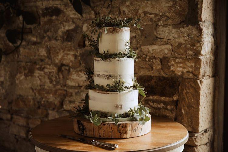 Semi Naked Wedding Cake on Tree Slice Cake Stand