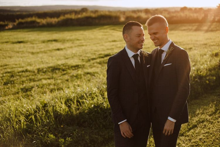 Golden Hour Portrait of Two Grooms at Their Gay Wedding