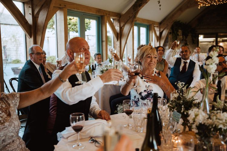 Wedding Guests Raising a Toast at the Gay Wedding