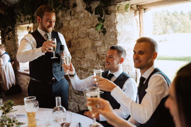 Best Man Raising a Toast to the New Mr & Mr