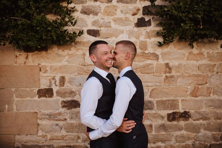 Two Grooms Embracing at their Gay Wedding