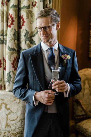 Groom in morning suits for classic wedding