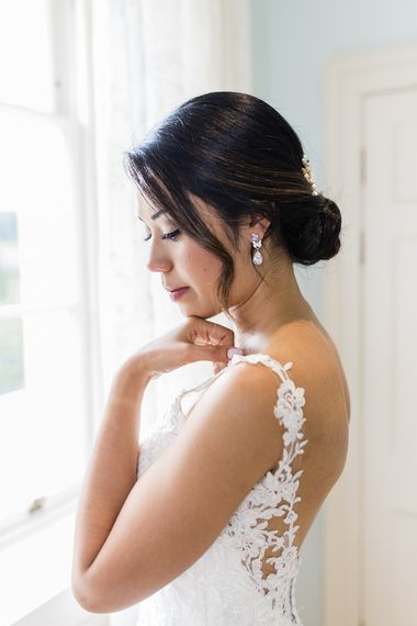 Low back lace detail wedding dress with low pinned updo