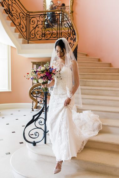 Bride with bouquet makes her way to ceremony