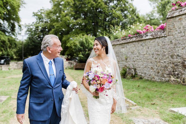 Bride makes her way to ceremony in Essense of Australia wedding dress
