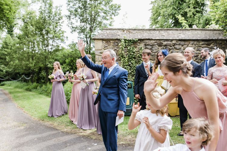 Guests wave to newlywed couple