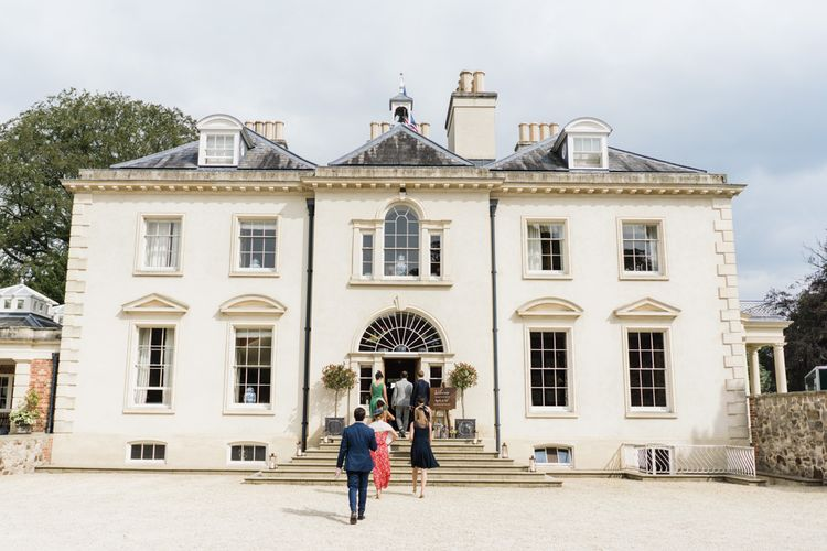 Rockley Manor wedding with morning suits and lace wedding dress