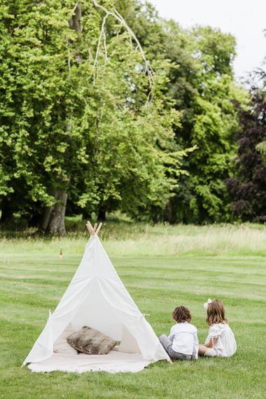 Kids area at wedding with small tipi