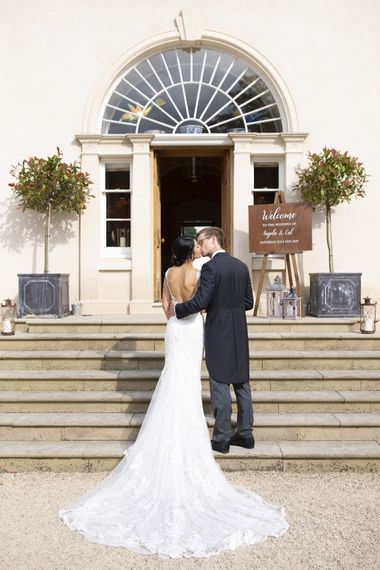 Low back wedding dress with groom in morning suits