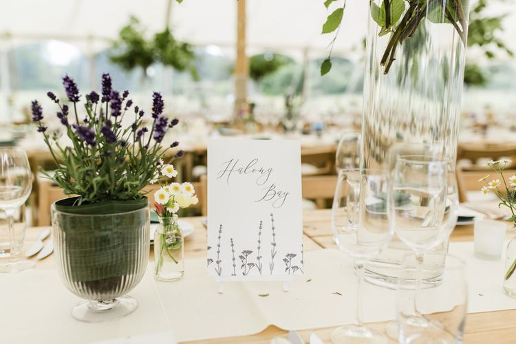 Wedding table decor at celebration with groomsmen wearing morning suits