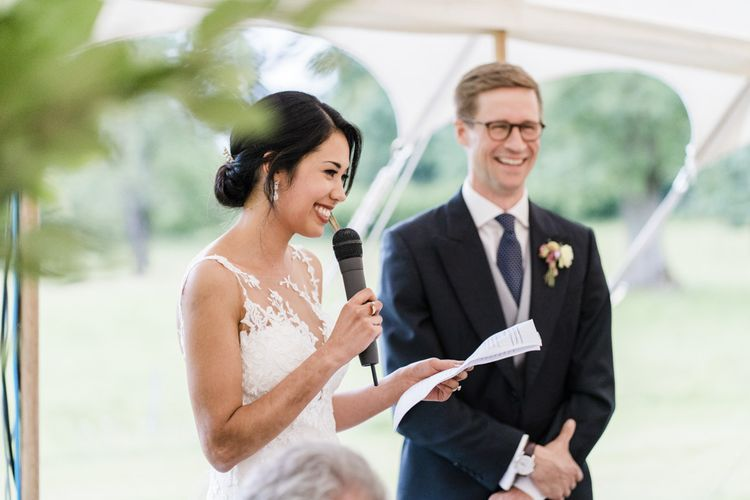Bride makes wedding speech with groom in morning suits