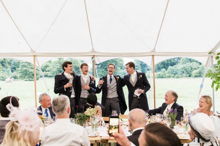 Groomsmen during wedding speeches wearing morning suits