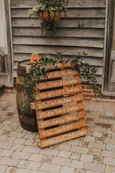 Pallet wedding sign with rustic foliage decor at The Ferry House Inn reception