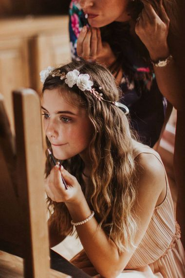 Bridesmaid wearing floral hair crown and nude dress for rustic wedding at The Ferry House Inn