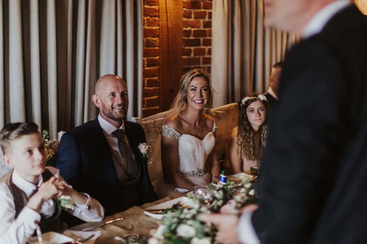 Bride and groom at The Ferry House Inn reception with rustic styling and floral decor