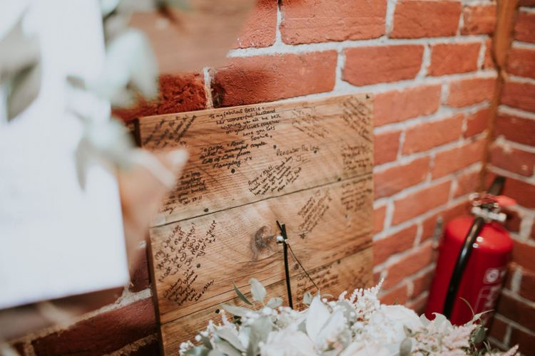 Homemade wooden clock with personal messages at rustic wedding