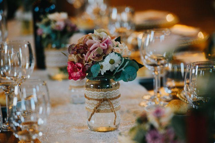 Flower Stems in Glass Jars Wedding Decor | Stylish Pink Wedding at Terzo di Danciano, Tuscany, Italy | Lucrezia Senserini Photography | Film by Righi Photography