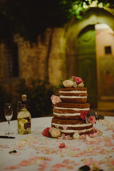 Naked Chocolate Wedding Cake | Stylish Pink Wedding at Terzo di Danciano, Tuscany, Italy | Lucrezia Senserini Photography | Film by Righi Photography