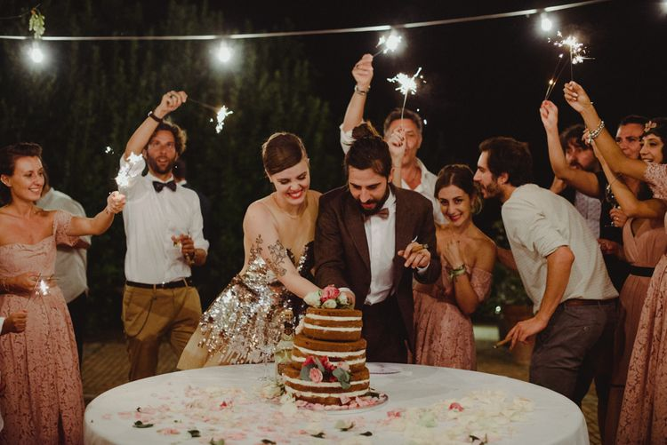 Cutting The Cake | Bride in Gold Glitter Second Dress | Groom in Brown Tweed Suit & Bow Tie | Stylish Pink Wedding at Terzo di Danciano, Tuscany, Italy | Lucrezia Senserini Photography | Film by Righi Photography