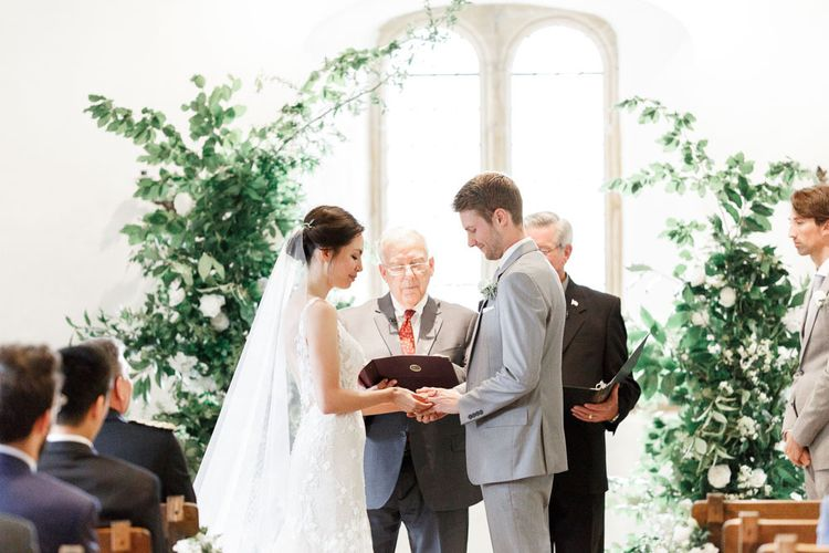 Bride and Groom Exchange Vows During Ceremony