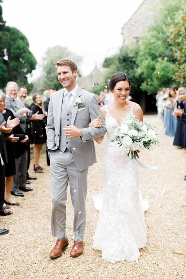 Groom In Pale Grey Suit As Bride Carried Wedding Bouquet