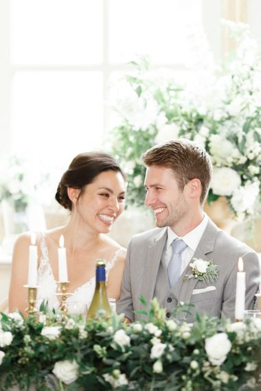 Couple Laugh As They Enjoy Wedding Speeches From The Blue Bridesmaid