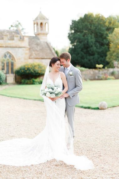 Bride Wears Martina Liana Wedding Dress and Groom In Blue Tie To Match The Bridesmaid Dresses