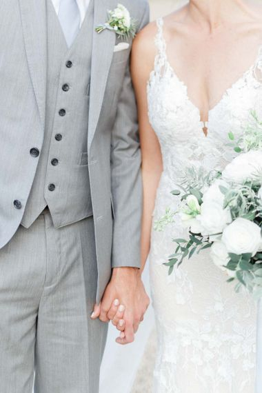 Grey Groom's Suit With White Wedding Flowers