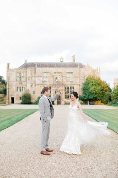 Bride and Groom Dance In Front Of Brympton House