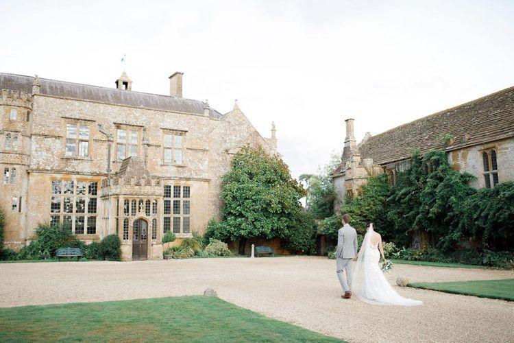 Bride and Groom Walk Through Grounds of Somerset Wedding Venue