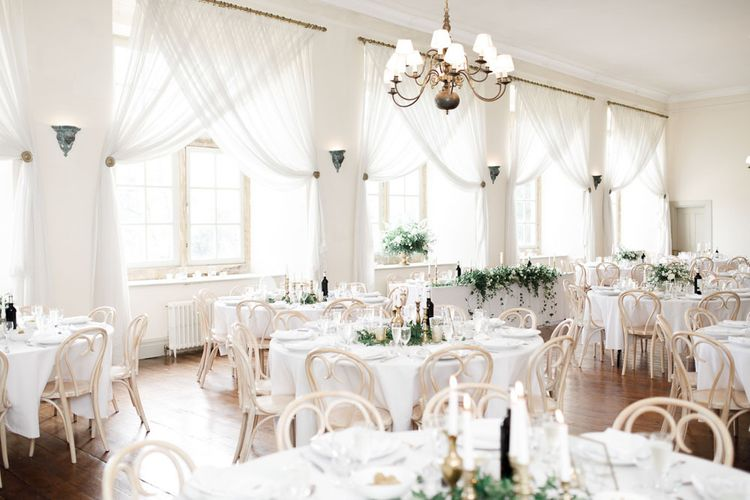 Wedding Table Set Up At Brympton House in Somerset with Blue Bridesmaids