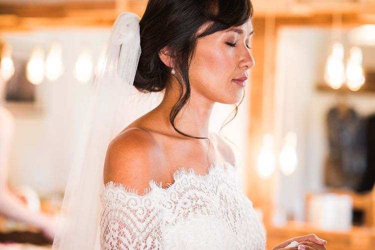 Bride in Lace Watters Dress with Bardot Neckline and Buttons Down Back | Blossom and Bluebird Cathedral Length Veil | Bridal Up Do | Smoke Bombs and Chinese Paper Fans Backdrop with Bride in Bardot Dress | Twig & Vine Photography