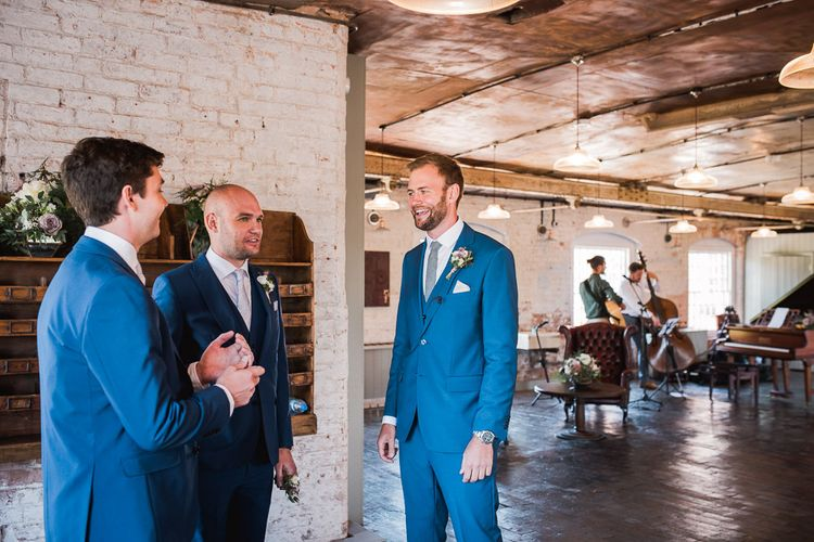 Groom in Royal Blue Three-Piece Suit from Moss Bros. with Silver Tie and Pocket Square from T.M.Lewin | Smoke Bombs and Chinese Paper Fans Backdrop with Bride in Bardot Dress | Twig & Vine Photography