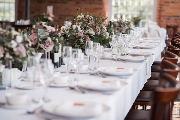 Dusky Pink Roses, White Peonies, Sweetpeas, Coffee-Coloured Phlox and Foliage in Hurricane Jars on Top Table | Wedding Reception at The West Mill | Smoke Bombs and Chinese Paper Fans Backdrop with Bride in Bardot Dress | Twig & Vine Photography