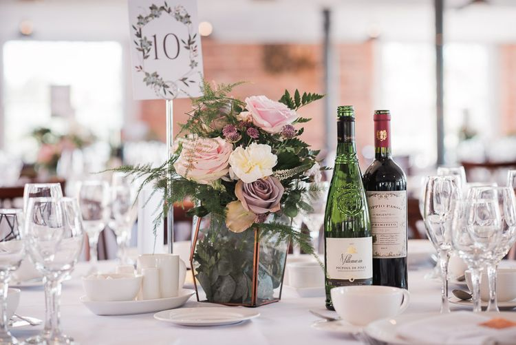 Copper Terranium Filled with Dusky Pink Roses, White Peonies, Sweetpeas, Coffee-Coloured Phlox and Foliage | Wedding Reception at The West Mill | Smoke Bombs and Chinese Paper Fans Backdrop with Bride in Bardot Dress | Twig & Vine Photography