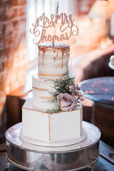 Three Tier Wedding Cake with Hexagon Bottom Layer and Semi-Naked Top Layers with Copper Drip Detail | Copper Calligraphy Cake Topper | Smoke Bombs and Chinese Paper Fans Backdrop with Bride in Bardot Dress | Twig & Vine Photography