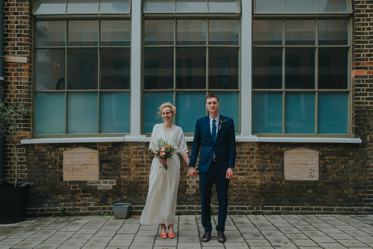 Bride in Wrap Front Wedding Dress | Groom in Navy Suit | Coral Peony Humanist Wedding at The Tab Centre Shoreditch | Remain in the Light Photography