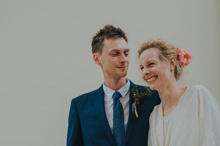 Humanist Wedding Ceremony | Bride in Wrap Front Wedding Dress | Groom in Navy Suit | Coral Peony Wedding at The Tab Centre Shoreditch | Remain in the Light Photography